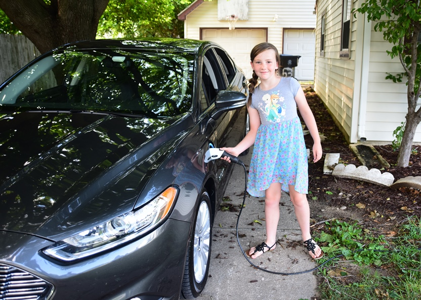 Girl Charges Electric Vehicle