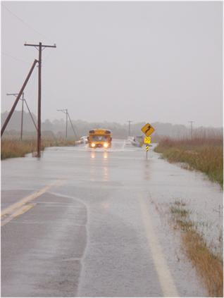 School Bus on a Flooded Road