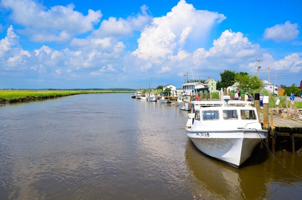 Fishing boats docked along a coastal river