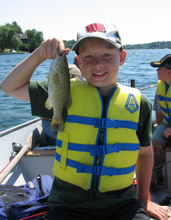 Youth with Fish and PFD