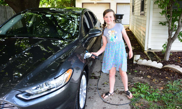 Child charging an electric car