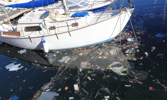 Boat with floating marine debris