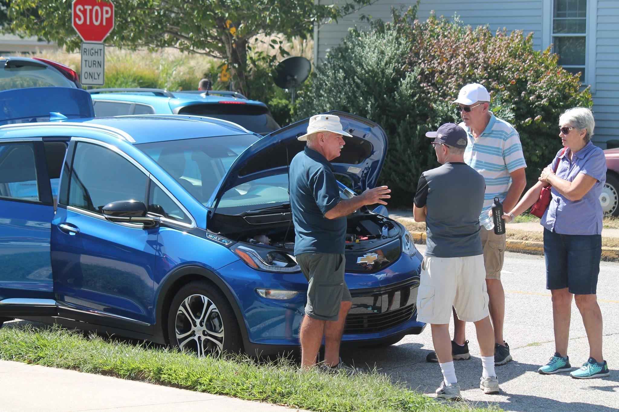 Dean Dey displays his electric vehicle