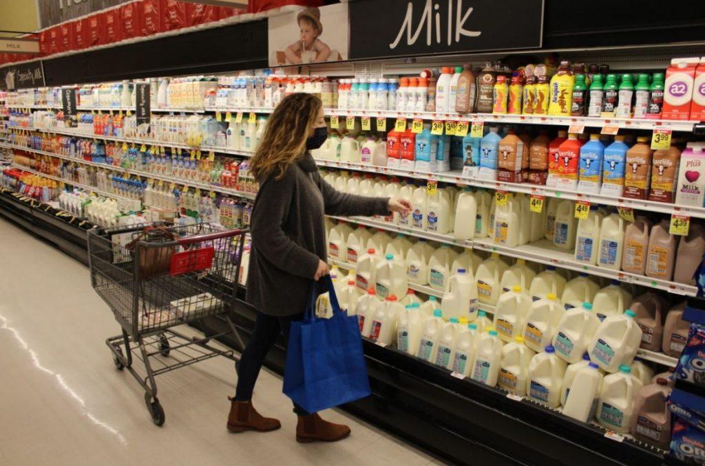 Shopper with a reusable bag